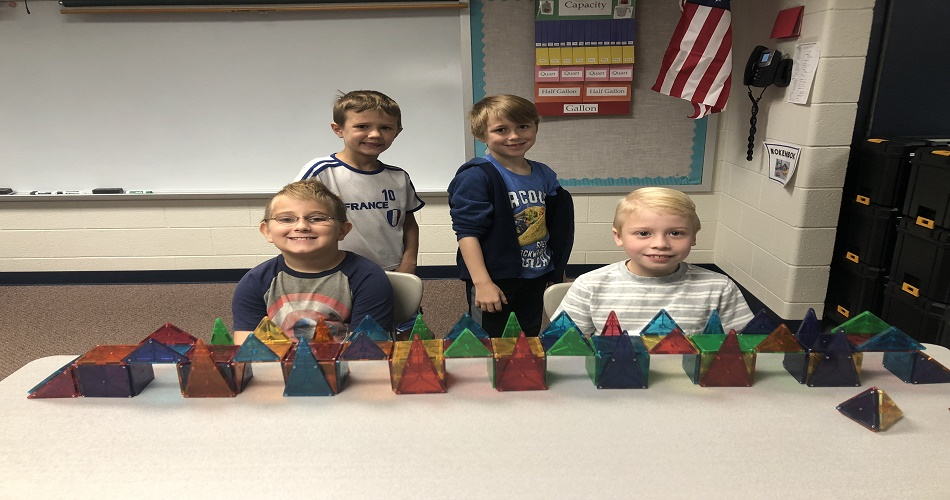 """Ms. O'Malley's class building bridges in the STEM Lab with magnatiles after reading """"Pop's Bridge""""."""