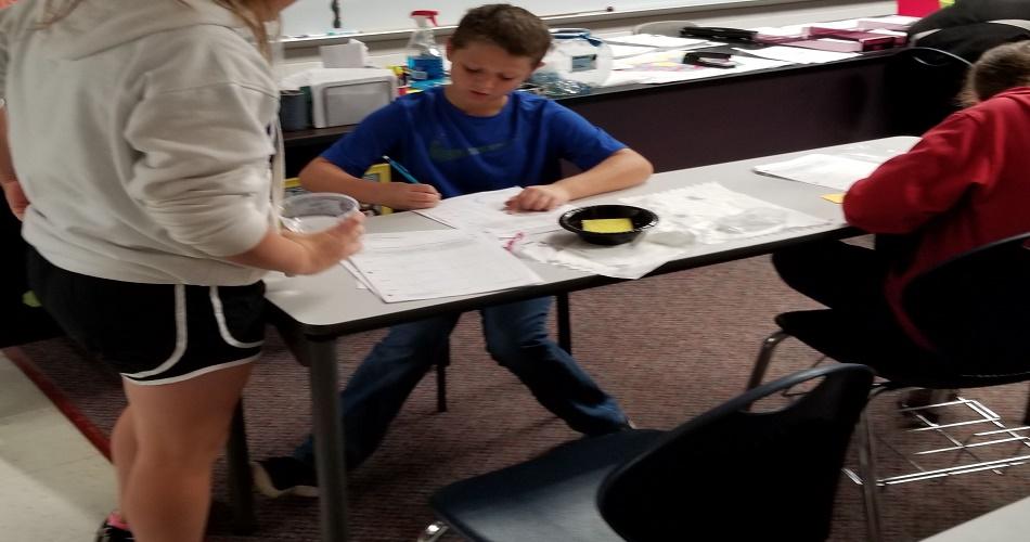 Mrs. Gulick's class doing an Oil Spill STEM activity
