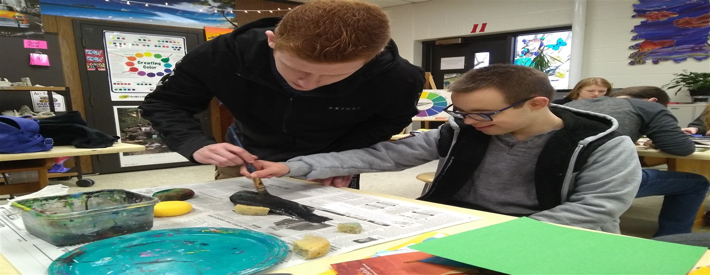 "Vinnie Markunas printing a ""real"" fish for Historical Japanese Fish Print with student helper Garrett Rokosky"