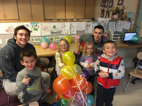 Susquehanna University Men's Basketball team visits kindergarten classes