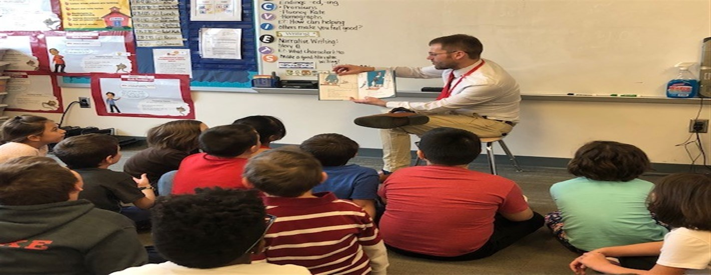 "Dr. Schmucker reading to students during ""Read Across America"" week"