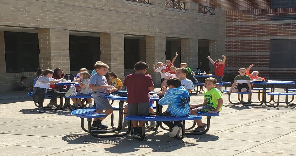 SAIS Students having lunch at our new outside tables.