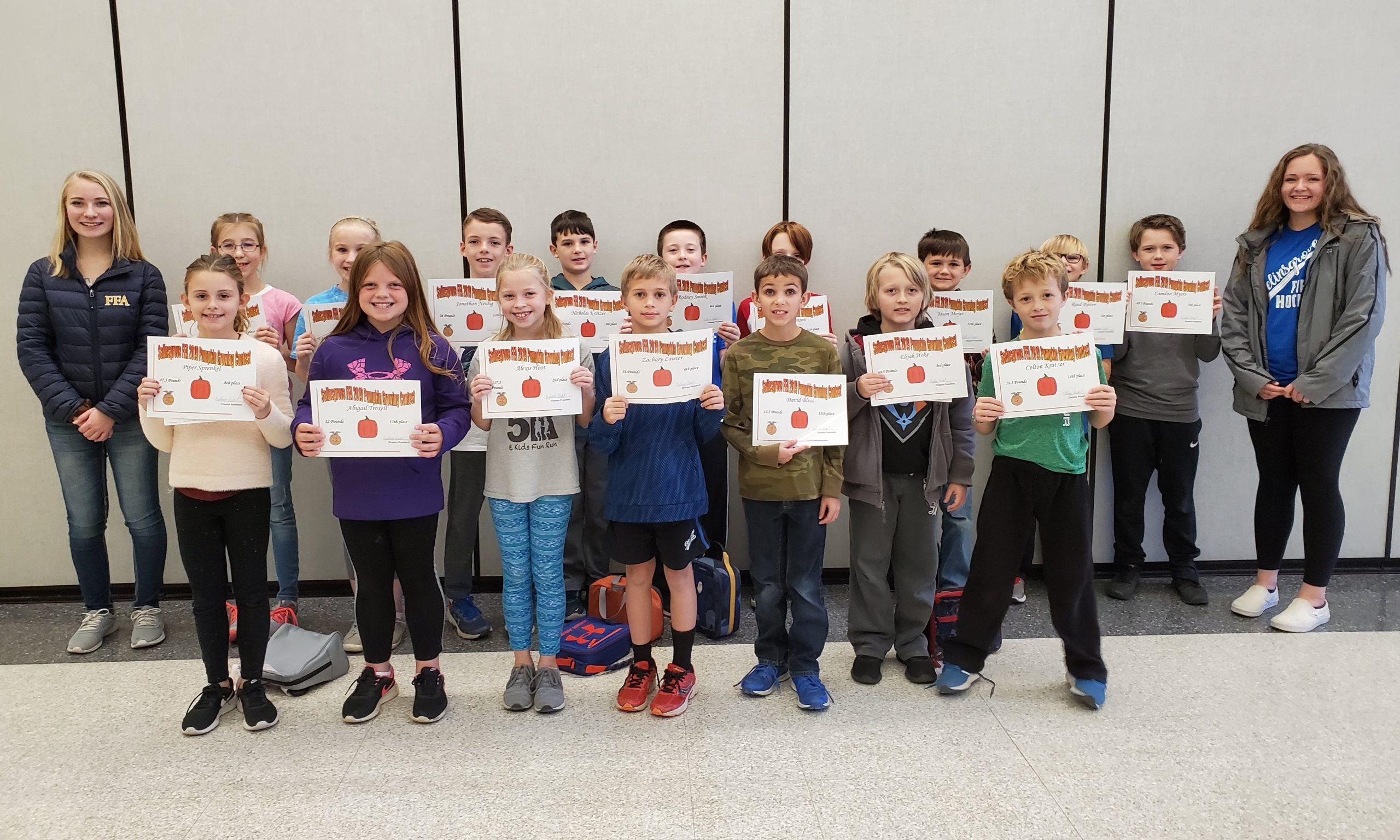 Grade 4 Pumpkin Growing Contest Winners with High School FFA Members