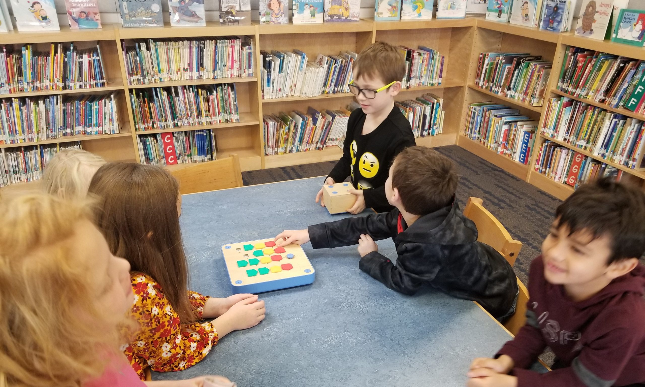 First Grade Students Learning Coding Skills Using Cubetto