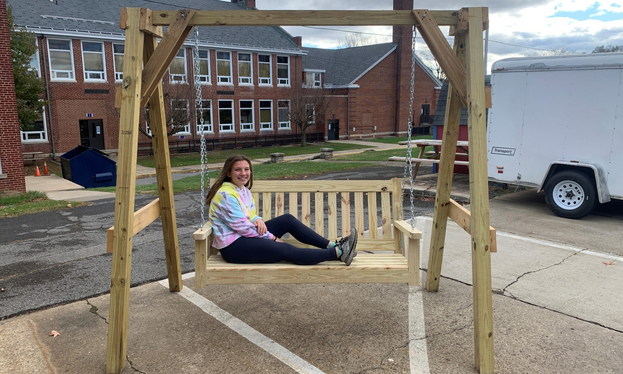 Annalise Bond relaxing in her arbor swing made in Mr. Aument's Advanced Materials class.