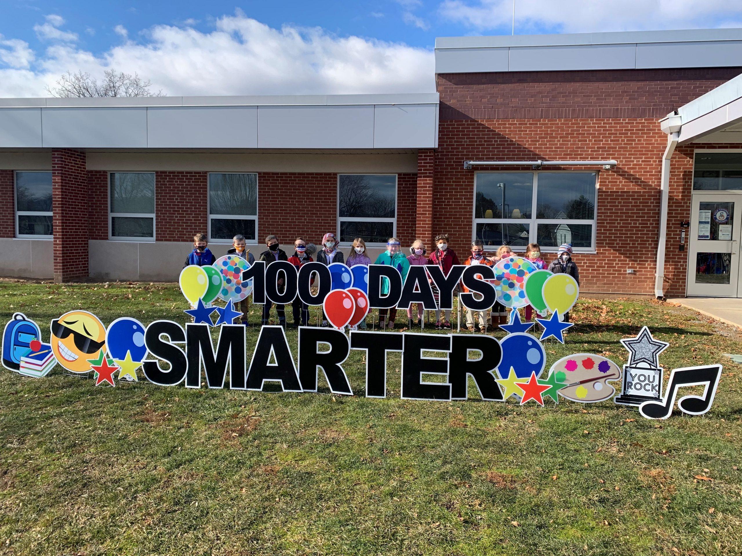 Mrs. Snarski's 1st grade class celebrating the 100th day of school