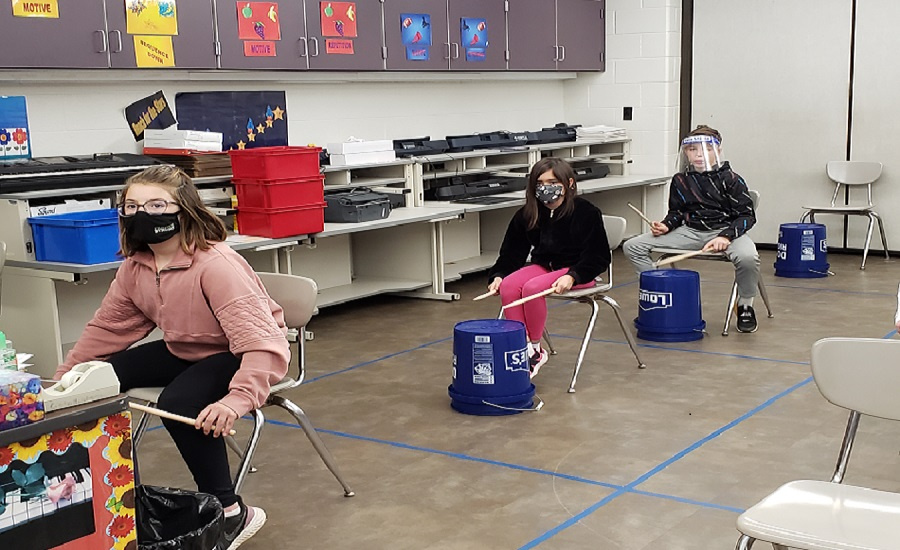 Mrs. Moyer's fifth grade class playing the bucket drums during music class