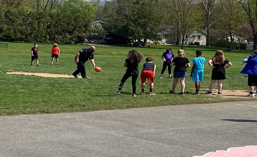 SAIS Students Playing Kickball With a Campus Police Officer